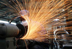 China factory activity at decade high but risks lurk