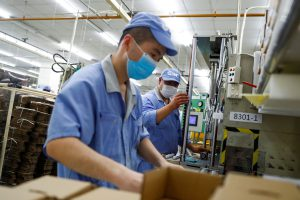 China's factory gate prices notch their first rise in 12 months
