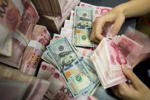 Yuan caught in global stock markets downdraft