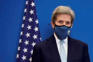 China faces uphill climate battle as Kerry arrives for talks