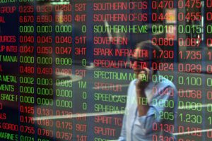 Asian markets edge down on low-key storm-hit day