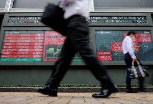 Traders concerned at Covid's return drag Asian markets down