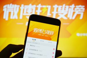 Sina joins exodus from US markets