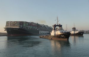 Ships go through Suez Canal after giant container vessel freed