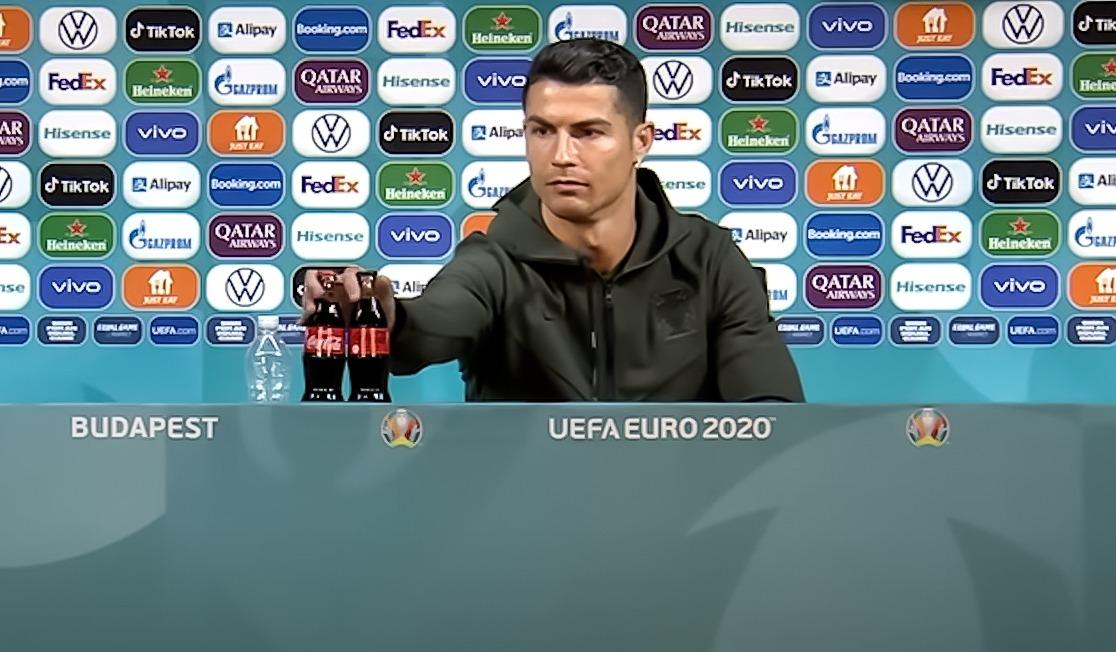 Cristiano Ronaldo removes bottles of Coca Cola