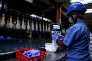 Asia's recovery stumbles as slow vaccine rollouts rein in output