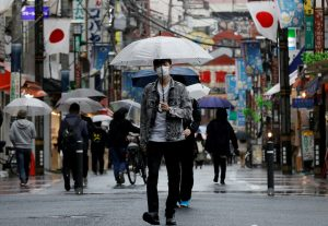 Japan's Growth Forecast Cut With Pandemic Curbs Set to Take a Toll
