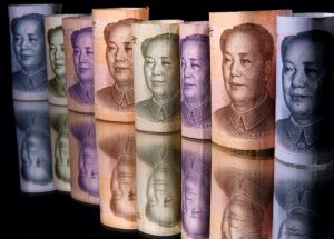 China's Currency Dips After Regulator Hints at Intervention